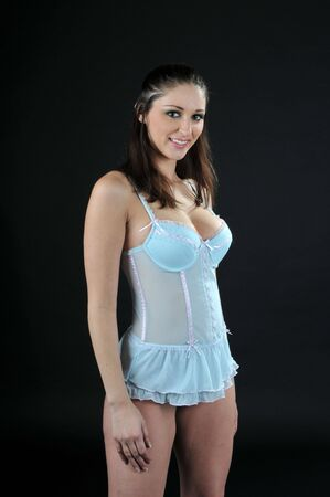 Beautiful brunette in a powder blue babydoll Stock Photo