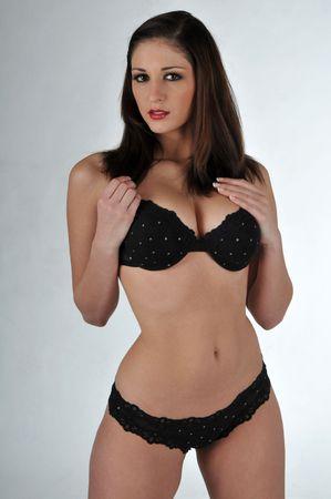 Beautiful brunette in black lingerie photo