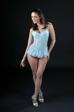 Beautiful brunette in a powder blue babydoll Stock Photo - 2425208