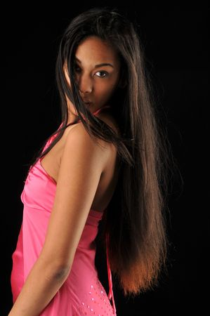 Long haired, dark skinned beauty against a black background