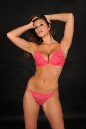 Beautiful brunette in pink lingerie photo