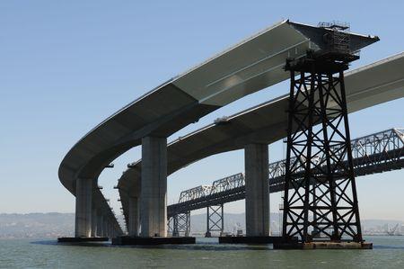 De San Francisco Bay Bridge, bestaande en nieuwe in aanbouw overspanningen Stockfoto