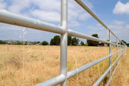 barrier: Steel pipe fence, San Martin, California