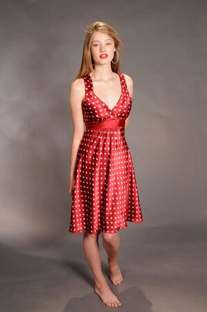 Auburn haired beauty in red polka dots