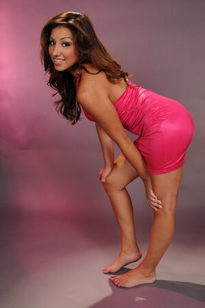 Brown haired beauty in a hot pink dress photo