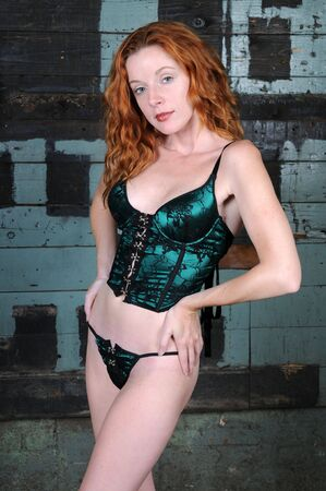 Beautiful pale skinned redhead in green lingerie Stock Photo - 3451889