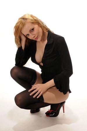medias mujer: Hermosa rubia vestida de negro, aisladas en blanco Foto de archivo