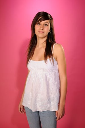 Pretty brown haired teenage girl in a white top and jeans Zdjęcie Seryjne