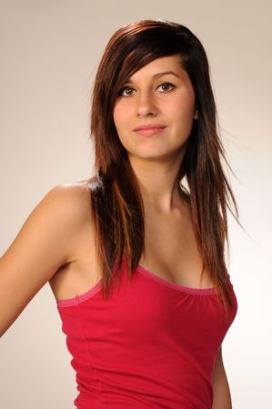 Pretty brown haired teenage girl in a bright pink top