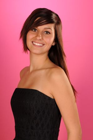 strapless: Pretty brown haired teenage girl in a black strapless dress