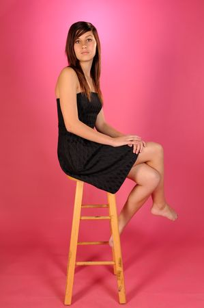 brown haired: Pretty brown haired teenage girl in a black strapless dress
