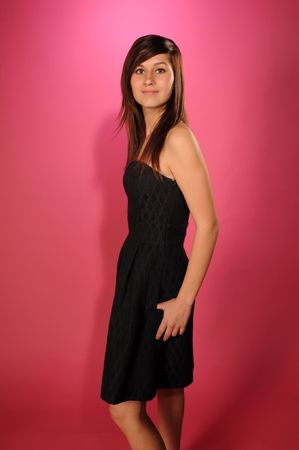 bare shoulders: Pretty brown haired teenage girl in a black strapless dress