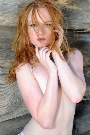 implied: Closeup on a pale skinned green eyed redhead