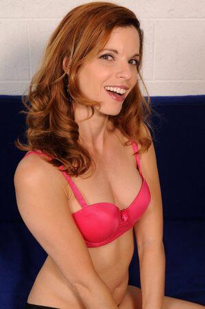 brassiere: Beautiful mature redhead in a pink brassiere