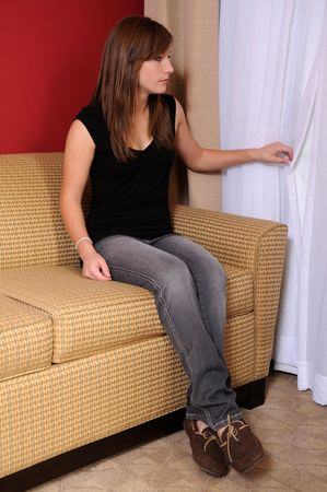 sofa: Pretty teen looking out the window