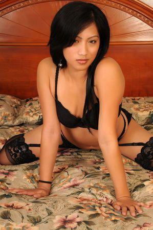 Beautiful Filipino girl in black lingerie Stock Photo - 3844713