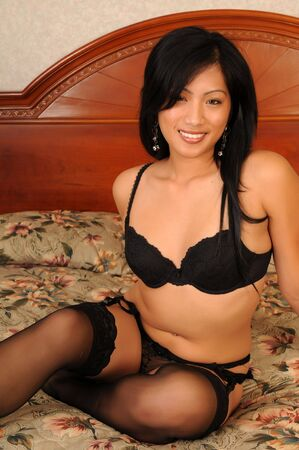 Beautiful Filipino girl in black lingerie photo