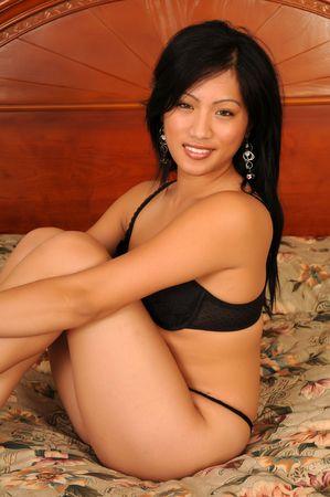 Beautiful Filipino girl in black lingerie photo
