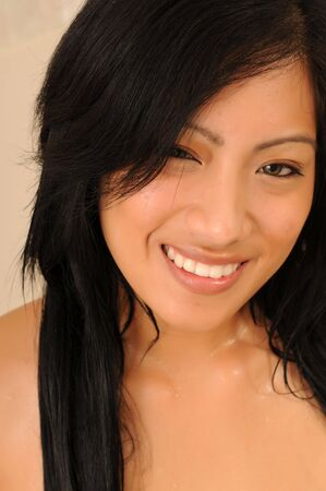 Closeup on the face of a beautiful young Filipino girl photo
