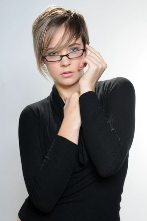 Beautiful girl with short hair and glasses