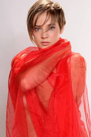 Beautiful short haired girl wrapped in transparent red cloth
