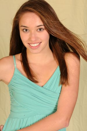 Pretty young teenage girl with long brown hair Stock Photo - 3904430