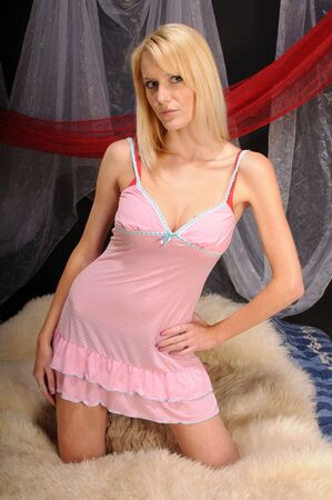 Beautiful blue eyed blonde in a pink baby doll photo