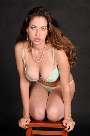 Beautiful brunette in light blue bra and panties