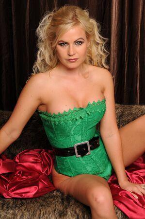Beautiful blonde dressed as a very sexy Santas helper