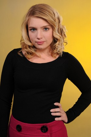 Pretty blonde teenager in a black sweater and a pink skirt Stock Photo - 4023138