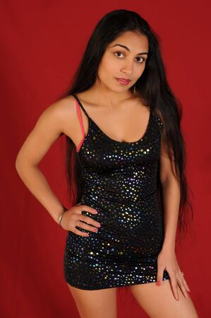 long: Beautiful long haired Indian woman in a black dress