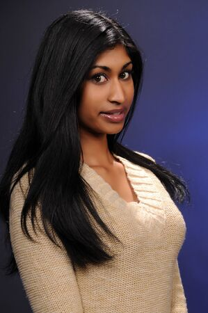 Beautiful young Indian woman in a beige knit blouse Stock Photo - 4247551