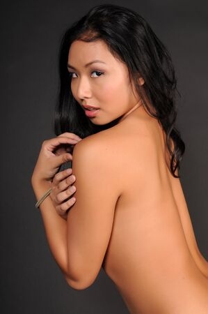 implied: Beautiful young Thai woman poses nude