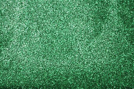 A glittery green paper decorative background
