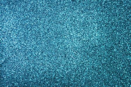 キラキラの青い紙の装飾的な背景