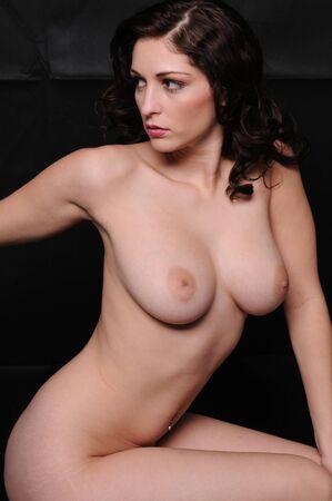 Beautiful brunette posing nude Stock Photo