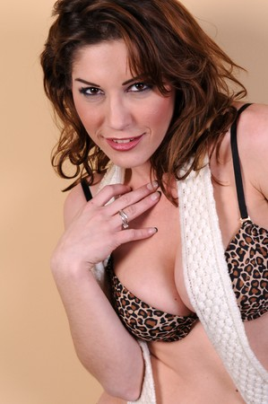 Pretty brunette in leopard print lingerie photo