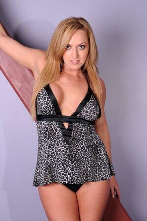 tall woman: Statuesque blonde in animal print lingerie