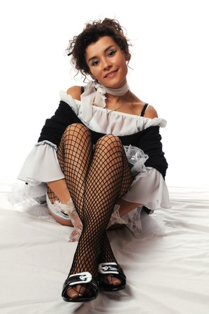 Pretty Colombian woman dressed as a French maid Stock Photo