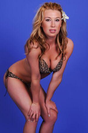 leopard print lingerie: Statuesque blonde woman in leopard print lingerie
