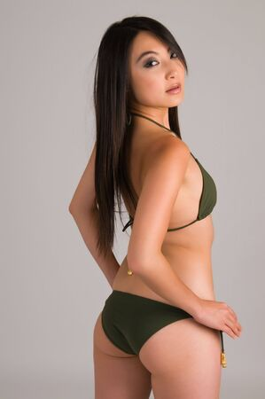 sexy asian woman: Beautiful young Asian girl in a dark green bikini