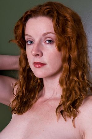 implied: Closeup on the beautiful face of a young redhead