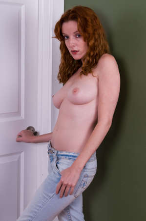 Beautiful young topless redhead in faded jeans Stock Photo - 4762539