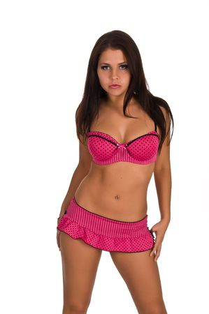 Beautiful young brunette in pink lingerie on white photo