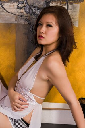 nightgown: Pretty young Asian woman in a white nightgown Stock Photo