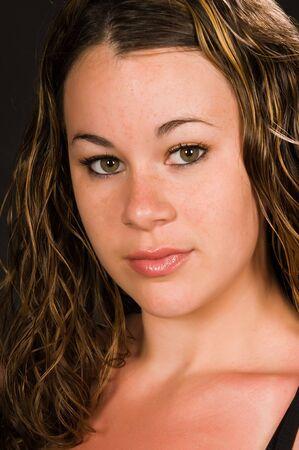 sunburned: Closeup on a pretty young brunette with sunburned skin