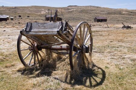 bodie: Old wagon in dry grass, Bodie State Historic Park, California