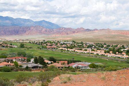Housing development against red rocks, Saint George, Utah Фото со стока