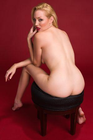 Tall beautiful blonde sitting nude on a stool Stock Photo - 5216269