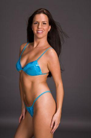 blue lingerie: Beautiful long haired brunette in blue lingerie